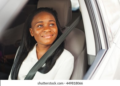 Young african american girl using seat belt in a car