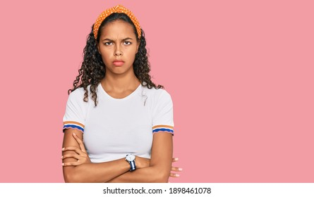 Young african american girl wearing casual clothes skeptic and nervous, disapproving expression on face with crossed arms. negative person.