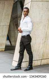 white shirt black pants white shoes