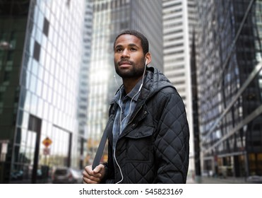 Young African American man in business district, photographed in NYC in November