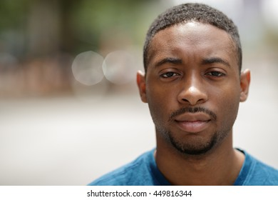 Young African American man in city serious face portrait