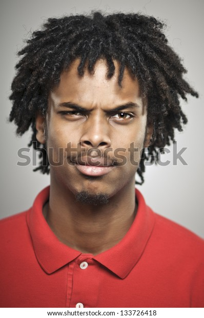 Young African American Man With Doubtful Expression
