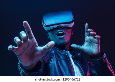 Young african american man having virtual reality experience using vr headset