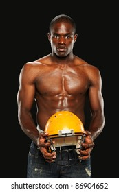 Young African American Man holding a Football  Helmet isolated on a dark background