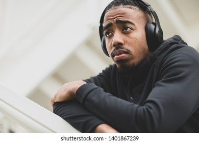 Young African American man listening to music.