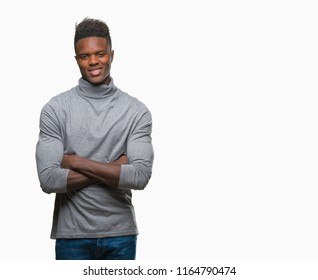 Young african american man over isolated background happy face smiling with crossed arms looking at the camera. Positive person.