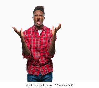 Young african american man over isolated background crazy and mad shouting and yelling with aggressive expression and arms raised. Frustration concept.
