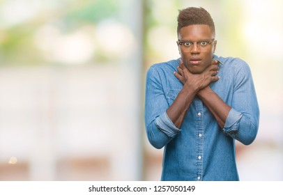 Young african american man over isolated background shouting and suffocate because painful strangle. Health problem. Asphyxiate and suicide concept.