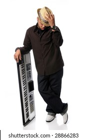 Young African American man posing next to electric piano