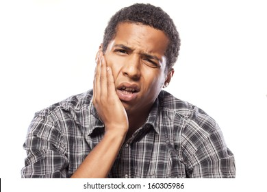 young African American young man with a strong toothache