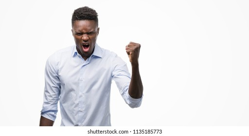 Young african american man wearing a shirt annoyed and frustrated shouting with anger, crazy and yelling with raised hand, anger concept