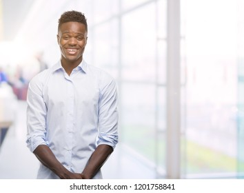 Young african american man wearing a shirt with a happy face standing and smiling with a confident smile showing teeth