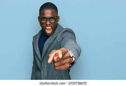 Young african american man wearing business clothes and glasses pointing displeased and frustrated to the camera, angry and furious with you