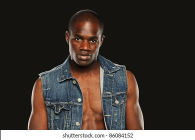 Young African American Man wearing a vest isolated on a gray background
