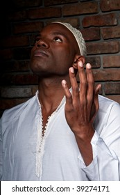 Young african american of muslim religion praying.