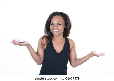 young african american presenting by pointing hands on side with phone smartphone in one
