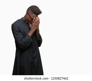 Young african american priest man over isolated background with sad expression covering face with hands while crying. Depression concept.