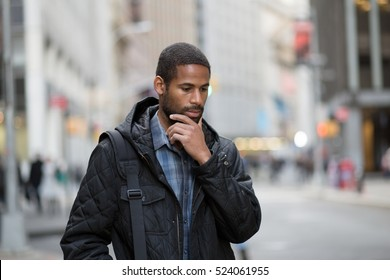 Young African American professional contemplating
