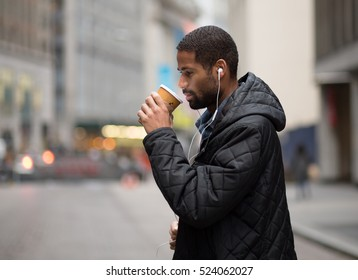 Young African American professional with a cup of coffee, photographed in NYC in November