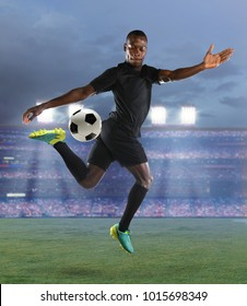 Young African American soccer player in accion inside large stadium
