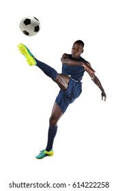 Young African American soccer player kicking ball isolated over white