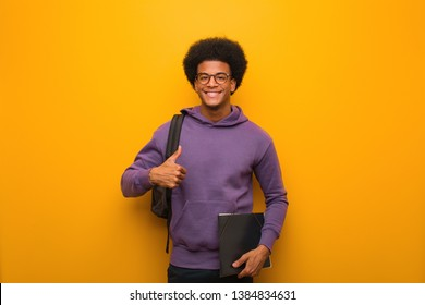 Young african american student man smiling and raising thumb up