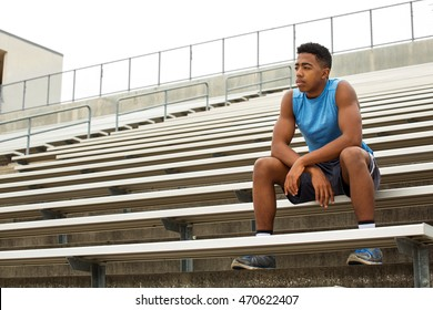 Young African American teenager contemplating his future.