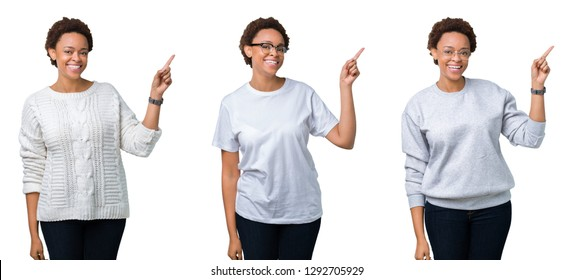 Young african american woman with afro hair over isolated background with a big smile on face, pointing with hand and finger to the side looking at the camera.