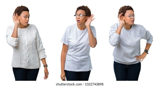Young african american woman with afro hair over isolated background smiling with hand over ear listening an hearing to rumor or gossip. Deafness concept.