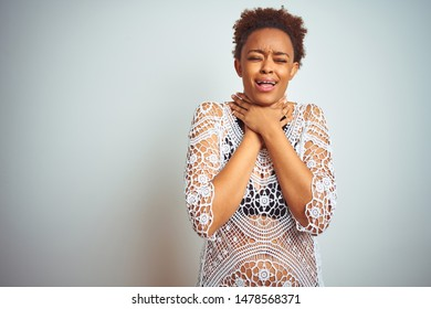 Young african american woman with afro hair wearing a bikini over white isolated background shouting and suffocate because painful strangle. Health problem. Asphyxiate and suicide concept.
