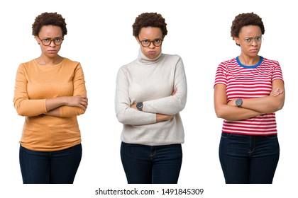 Young african american woman with afro hair wearing glasses skeptic and nervous, disapproving expression on face with crossed arms. Negative person.