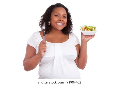 Young african american woman eating salad, isolated on white background