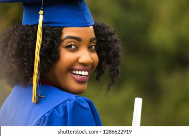Young African American Woman at graduation.
