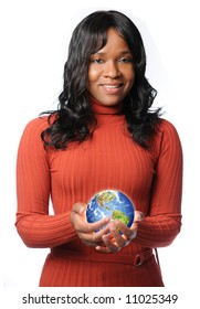 Young African American woman holding glowing earth