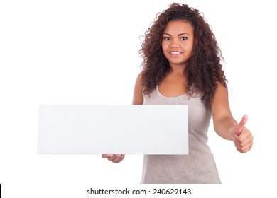 Young African American woman holding blank sign isolated