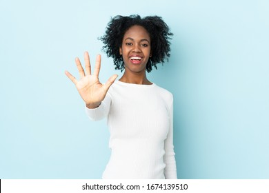 Young African American woman isolated on blue background counting five with fingers