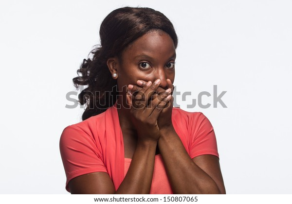 Young African American woman keeps quiet, horizontal