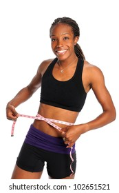 Young African American woman measuring waist with tape isolated over white background