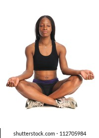 Young African American woman meditating sitting isolated over white background