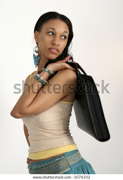 Young African American woman portfolio slung over her shoulder