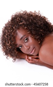 Young African American woman portrait bare shoulders