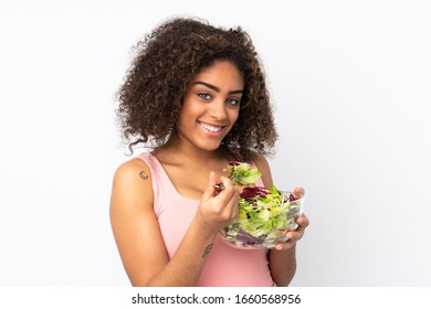 Young  African American woman with salad isolated on white background