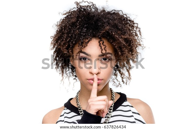 young african american woman with silence gesture looking at camera isolated on white