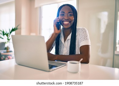 Young african american woman smiling happy working using laptop at home