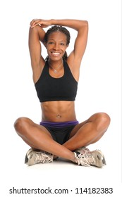 Young African American woman stretching isolated over white background