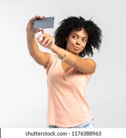 Young African American woman taking a selfie - self portrait - Black teenager people