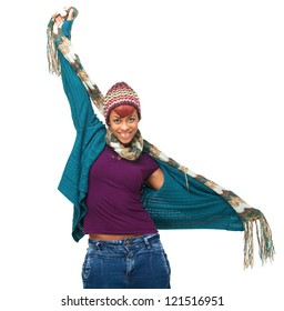 Young African American woman wearing winter clothes and holding her arms out. Pretty African model is excited and has a fun, happy expression on her face. Isolated on white background