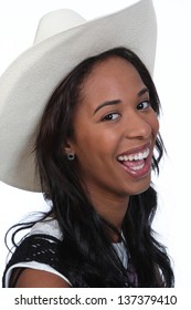 Young African American woman wearing a cowboy hat.