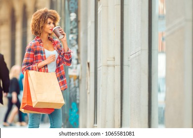 Young african american woman window shopping