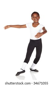 Young African ballet boy on white background and reflective white floor showing various ballet steps and positions. Not Isolated